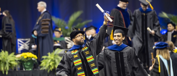 Graduates celebrate at a commencement ceremony